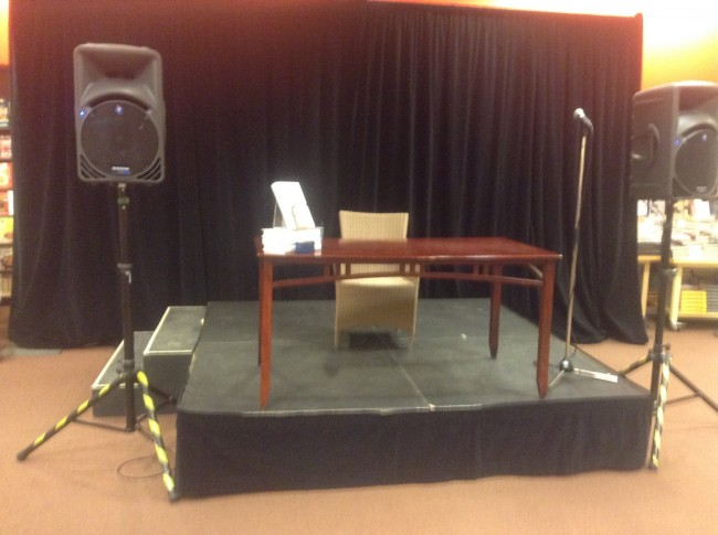 The stage and signing chair await the arrival of Mr. Cleese.